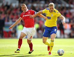 Nottingham Forest's Ben Watson (left) and Birmingham City's Kristian Pedersen battle for the ball