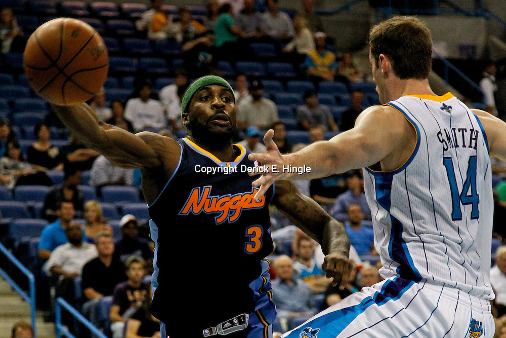 April 4, 2012; New Orleans, LA, USA; Denver Nuggets point guard Ty Lawson (3) passed the ball past New Orleans Hornets power forward Jason Smith (14) during the second half of a game at the New Orleans Arena. The Hornets defeated the Nuggets 94-92.  Mandatory Credit: Derick E. Hingle-US PRESSWIRE