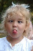 A child makes faces.