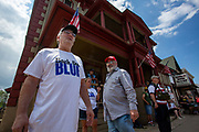"""Watsontown, PA (June 28, 2020) -- Counter protesters gathered in front of the Mansion House Bar & Grill during a Black Lives Matter protest in Watsontown, PA. About 200 people gathered at the intersection of Main Street and Primmer Avenue before marching through the streets. They were confronted by nearly 50 counter-protesters. Local activist group """"If Not Us, Then Who?"""" organized the event."""