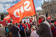 A supporter waves a flag with the logo of the SPD during an election campaign event of the German Social Democratic Party (SPD) at Bebelplatz square In Berlin, Germany, August 27, 2021. Germany's federal elections are due to take place on September 26, 2021.