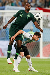 June 26, 2018 - Saint Petersburg, Russia - Odion Ighalo (top) of Nigeria national team and Nicolas Tagliafico of Argentina national team vie for the ball during the 2018 FIFA World Cup Russia group D match between Nigeria and Argentina on June 26, 2018 at Saint Petersburg Stadium in Saint Petersburg, Russia. (Credit Image: © Mike Kireev/NurPhoto via ZUMA Press)