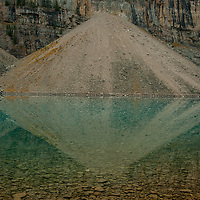 Avalanche debris from Mount Babel reflects in Moraine Lake in Banff National Park, Alberta, Canada.