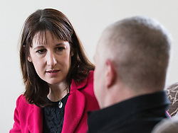 © Licensed to London News Pictures . 04/02/2014 . Sale , UK . RACHEL REEVES listening to Tony Gunning . Rachel Reeves , MP for Leeds West and Shadow Secretary of State for Work and Pensions and Chris Bryant , MP for Rhondda and Shadow Minister for Welfare Reform , join Labour candidate Mike Kane on the campaign trail ahead of the Wythenshawe and Sale East by-election , following the death of MP Paul Goggins . They visit the home of Tony Gunning (51) who suffers from hereditary adult polycystic kidney disease and is on dialysis , who says he is affected by the bedroom tax . Photo credit : Joel Goodman/LNP