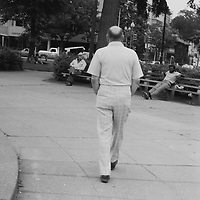 """1. When was this photo taken? <br /> <br /> June 1980<br /> <br /> 2. Where was this photo taken? <br /> <br /> Dupont Circle Washington DC<br /> <br /> 3. Who took this photo? <br /> <br /> Jonathan Schaefer<br /> <br /> 4. What are we looking at here? <br /> <br /> An unknown man walks away from the camera (Canon FT) in the middle of Dupont Circle. This image would be what my mother called an """"art shot"""".<br /> <br /> 5. How does this old photo make you feel? <br /> <br /> Surprised that I took this urban scene with strangers in it.<br /> <br /> 6. Is this what you expected to see? <br /> <br /> No...I only knew that the roll of film was exposed on 6/10/1980 and had no idea what images would be on it.<br /> <br /> 7. Does this photo bring back any memories? <br /> <br /> Yes, I was working for the Civil Aeronautics Board at the Universal Building on Connecticut Avenue, north of Dupont Circle in Washington, DC at the time. I used to bring my camera to work and would often spend my lunch hour walking the streets or sitting in the local park. But I don't remember why I took this picture.<br /> <br /> 8. How do you think others will respond to this photo? <br /> <br /> Perhaps an appreciation of the aesthetics of the composition and the grainy black & white film image."""