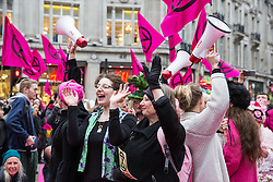 London, UK. 12th April 2019. Climate campaigners from Extinction Rebellion take over Oxford Circus, the heart of London's shopping district, to host a catwalk by sustainable fashion brands and art and fashion students to draw attention to the impact of unsustainable fashion and as part of a protest to call on the Government to take urgent action to address climate change.
