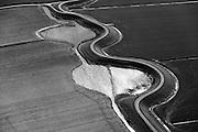 Nederland, Noord-Holland, Gemeente Zijpe, 20-04-2015;<br /> Burgerwielen, Westfriese Zeedijk, ten noordwesten van Tuitjenhorn. Grazende koeien in het weiland. De wielen zijn restanten van vroegere dijkdoorbraken.<br /> Westfriese Omringdijk, part of the 'Westfrisian Surrounding Dike'. The water is the remnant of dike breaches is the past.<br /> luchtfoto (toeslag op standard tarieven);<br /> aerial photo (additional fee required);<br /> copyright foto/photo Siebe Swar