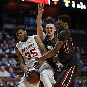 Steven Spieth, (center), Brown, challenges for the rebound with Phil Lawrence-Ricks, Marist, assisted by team mate 	Jason Massey, (right),  during the Marist vs Brown Men's College Basketball game in the Hall of Fame Shootout Tournament at Mohegan Sun Arena, Uncasville, Connecticut, USA. 22nd December 2015. Photo Tim Clayton