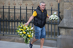 © Licensed to London News Pictures . 20/09/2014 . Manchester , UK . A man arrives bringing flowers . Arrivals at the funeral of Heywood and Middleton MP Jim Dobbin at Salford Cathedral today (Saturday 20th September 2014) . Photo credit : Joel Goodman/LNP