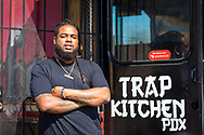 Mikey, Manager at Trap Kitchen, a food cart on SE 82nd. Ave in Portland, Oregon.