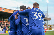AFC Wimbledon defender Steve Seddon (15) and team mates celebrating after scoring goal during the EFL Sky Bet League 1 match between AFC Wimbledon and Doncaster Rovers at the Cherry Red Records Stadium, Kingston, England on 9 March 2019.