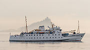 Got up early this morning, melting overnight. Went out for some cool air in the thick sea fog. After about an hour the fog thinned and just a mist remained. At 9.08 am, just ahead of schedule, the Scillonian III slipped it's warps and gently steamed past St Michaels Mount on its 2 3/4 hr journey to St Mary's on the Isles of Scilly. <br /> <br /> Had several images from this morning that I really liked but just had to post this one first as two iconic subjects lined up. Even saw dolphins breaching this morning. Quite magical.