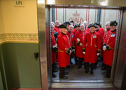 © Licensed to London News Pictures. 07/11/2014.  London. The Chelsea Pensioners from the Royal Hospital Chelsea hop in a lift at the Royal Albert Hall before today's Festival of Remembrance.  First broadcast in 1927 the festival has now been held in the Royal Albert Hall for 87 years.  Photo credit : Alison Baskerville/LNP