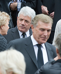 © licensed to London News Pictures. 18/05/2011. Tonbridge, UK. Kevin Keegan and Sir Trevor Brooking at the funeral of heavyweight boxing legend Sir Henry Cooper at Corpus Christi Church in Lyons Crescent, Tonbridge, Kent today (18/05/2011).  Please see special instructions for usage rates. Photo credit should read Ben Cawthra/LNP