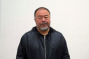 Chinese artist Ai Weiwei poses for photographers at the opening of  his new exhibition Ai Weiwei: Roots at the Lisson Gallery, London, United Kingdom on 1st October 2019.
