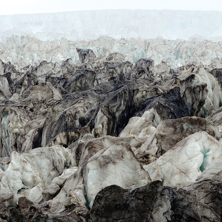 """""""Mist"""" - Surface of Wahlenbergbreen completely broken up because of the surge. A huge drop in ice level can the seen in the misy back which is a result of the glacier being pushed over bedrock."""