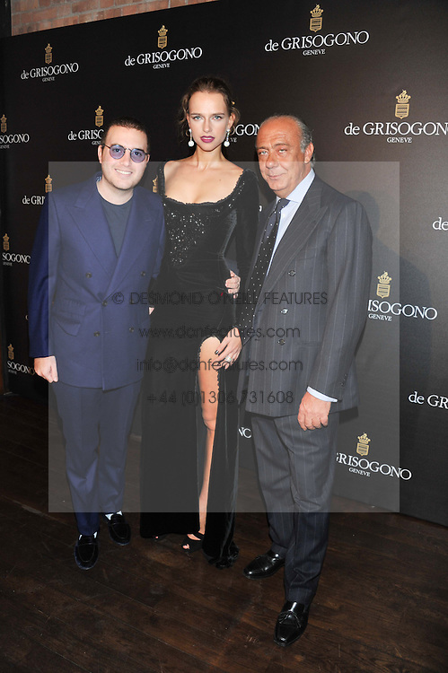 Left to right, DAVID WERTHEIMER, MASHA RUDENKO and FAWAZ GRUOSI at a dinner hosted by de Grisogono at 17 Berkeley Street, London on 12th November 2012.