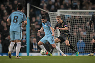 Nolito (Manchester City) and Jozo Šimunović (Celtic) during the Champions League match between Manchester City and Celtic at the Etihad Stadium, Manchester, England on 6 December 2016. Photo by Mark P Doherty.