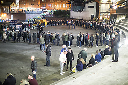 """© Licensed to London News Pictures . 03/11/2017 . Manchester , UK . Hundreds of fans of Tommy Robinson (real name Stephen Yaxley-Lennon ) queue for a signed copy of the book as anti-fascist counter demonstrators protest at the launch of the former EDL leader's book """" Mohammed's Koran """" at Castlefield Bowl . Originally planned as a ticket-only event at Bowlers Exhibition Centre , the launch was moved at short notice to a public location in the city . Photo credit : Joel Goodman/LNP"""