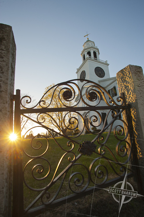 Church On The Hill in Lenox, Massachusetts seen through one of it's vintage, wrought iron, decorative gates.