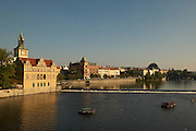 Czeck Republic - Prague, Boat rentals tour the river in front of the Bed?ich Smetana Museum (left).  The buildings along Smetanovo Náb?e?í line the Vltava river through the center of the city.
