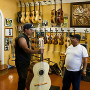 Tomas Delgado carries on the family tradition of hand crafting acoustic guitars and string instruments in a small room behind the storefront on Cesar Chavez Blvd in East Los Angeles. The Delgado family is world renowned for their craftsmanship in making and repairing guitars. Please contact Todd Bigelow directly with your licensing requests.
