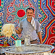 A konafa maker shows off his handiwork at Rashid market. This vermicelli-like pastry is the main ingredient in the sweet, especially popular during Ramadan.