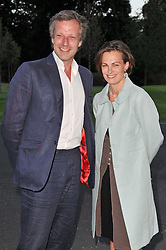 HUGO BURNAND and his wife LOUISA at the opening party of the London Syon Park - A Waldorf Astoria Hotel, Syon Park, Middlesex on 19th May 2011.