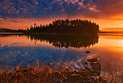 Clouds reflected on Fungus Lake at sunrise<br />West of Wawa<br />Ontario<br />Canada