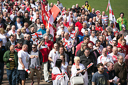 © Licensed to London News Pictures. 23/04/2015. Nottingham, UK. The Nottingham St George's parade took part today. The parade met in Forest Recreation Ground. An estimated two hundred people with trucks playing patriotic music and horses dressed in flags made their way along the streets into the City Centre. Pictured, crowds make their way along the streets. Photo credit : Dave Warren/LNP