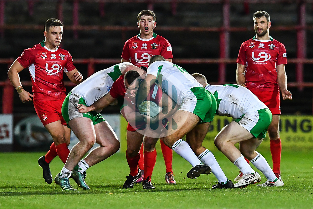 11th November 2018 , Racecourse Ground,  Wrexham, Wales ;  Rugby League World Cup Qualifier,Wales v Ireland ; Steve Parry of Wales is gang tackled by the Ireland defence<br /> <br /> <br /> Credit:   Craig Thomas/Replay Images