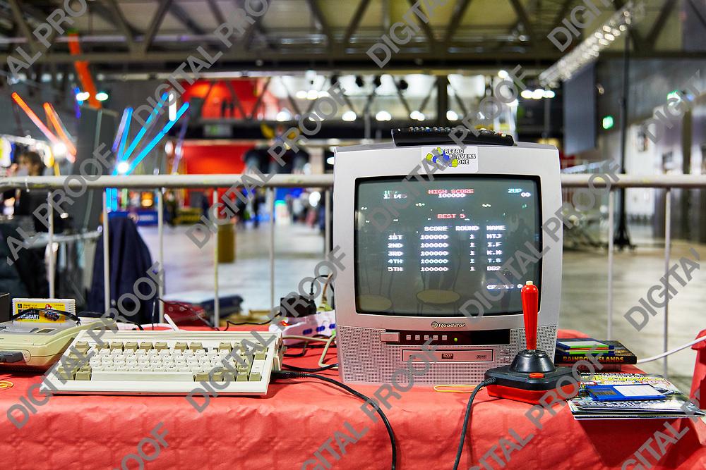 Milan, Italy - March 8 2019 Cartoomics Comic Con A visitor plays retro vintage games of Nintendo