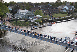© Licensed to London News Pictures. 10/05/2021. London, UK. A crowd gathers on a bridge as rescuers reach a young minke whale trapped in the River Thames at Teddington Lock in south west London. Fire crews and the British Divers Marine Life group worked with an Rescue Royal National Lifeboat Institute (RNLI) crew in an eff cinnamonort to save the whale after it got stuck last night. But it is now free . Photo credit: Peter Macdiarmid/LNP