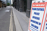 Plain clothes police operate in this area sign due to anti-social behaviour in this area of the City of London on 1st July 2020 in London, United Kingdom.
