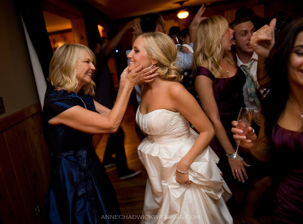 A bride is greeted by her mother at her wedding reception at Forest House Lodge in Foresthill, CA.