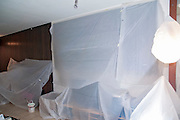 House remodeling. Furniture covered with plastic before painting