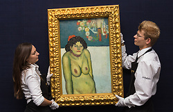 "Sotheby's, Mayfair, London, October 9th 2015. Expected to fetch up to $60,000,000 at auction, Sotheby's presents ""the finest Blue Period Picasso to come to market in a generation"", painted in 1901 when Pablo Picasso was just shy of 20 years old. PICTURED: Sotheby's Gallery Technicians hang the Picasso for the London preview ahead of its New York auction. // Contact: paul@pauldaveycreative.co.uk Mobile 07966 016 296"