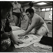 signing autographs ..Morning  workout session in the Sado Gatake stable, 30 minutes west of Tokyo, .