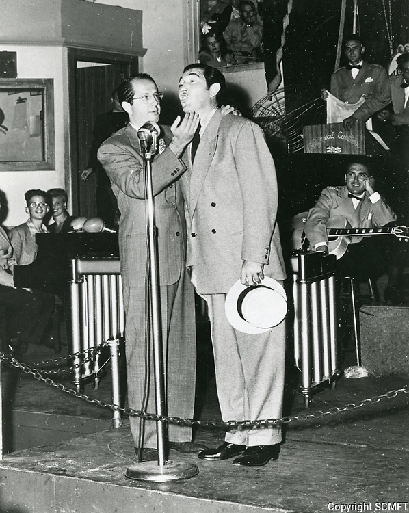 1943 Phil Silvers clowns with Ray Milland on stage at the Hollywood Canteen