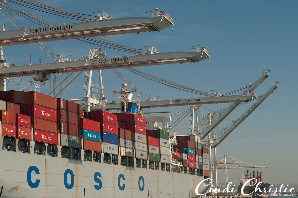 Containers are loaded onto the Cosco Antwerp in the Port of Oakland in Oakland, Calif.,  on Saturday, Sept. 17, 2011. The cargo ship flies the flag of the United Kingdom. (© 2011 Cindi Christie/Cyanpixel Photography)