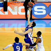 Anadolu Efes's Cedi Osman (C) during their Turkish Airlines Euroleague Basketball Group A Round 5 match Anadolu Efes between Real Madrid at Abdi ipekci arena in Istanbul, Turkey, Thursday, November 14, 2014. Photo by Aykut AKICI/TURKPIX