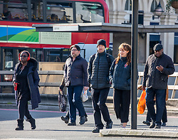 © Licensed to London News Pictures. 24/03/2020. London, UK. Commuters on their way to work at Vauxhall this morning as Prime Minister Boris Johnson orders a police enforced lock-down on the UK as people are banned from leaving home except for food, medical reasons, exercise and essential work as the coronavirus crisis continues. Photo credit: Alex Lentati/LNP