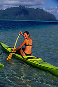 Polynesian woman, outrigger canoe, Kaneohe Bay, Oahu, Hawaii<br />