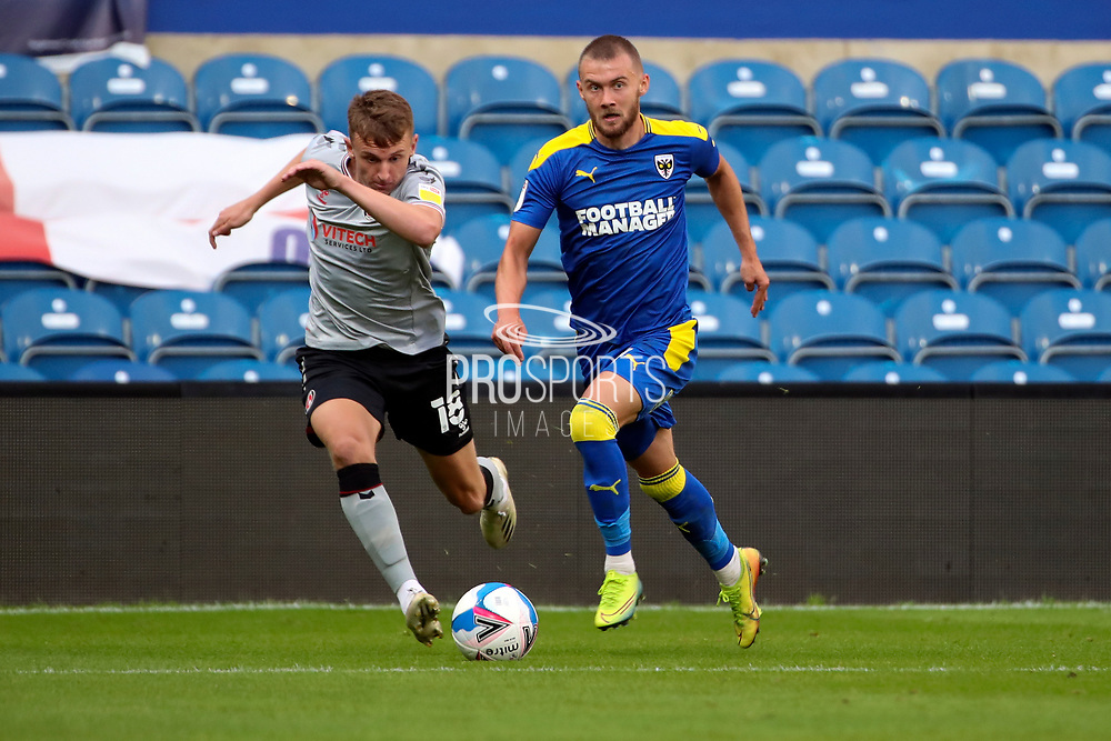 AFC Wimbledon attacker Shane McLoughlin (19) dribbling during the EFL Trophy Group O match between AFC Wimbledon and Charlton Athletic at the Kiyan Prince Foundation Stadium, London, England on 1 September 2020.
