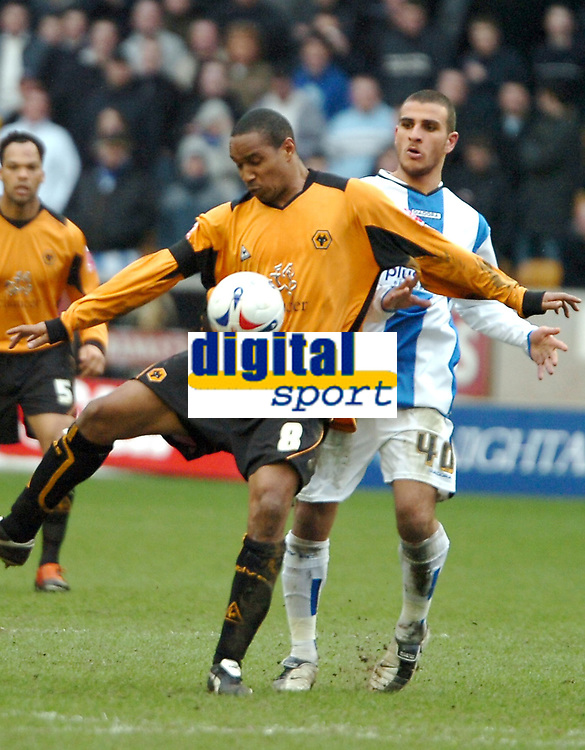 Photo: Ed Godden.<br />Wolverhampton Wanderers v Sheffield Wednesday. Coca Cola Championship. 25/03/2006. <br />Wolves' Paul Ince (L) shields the ball from Wednesday's Marcus Tudgay (R).