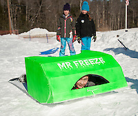 "Alex Richardson preps his sled ""Mr. Freeze"" for the Gilford Parks and Recreation Cardboard Derby on Wednesday morning.  (Karen Bobotas/for the Laconia Daily Sun)"