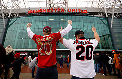 Manchester United fans wearing kits with the name of Manchester United's new interim manager Ole Gunnar Solskjaer on the back before the Premier League match at Old Trafford, Manchester.