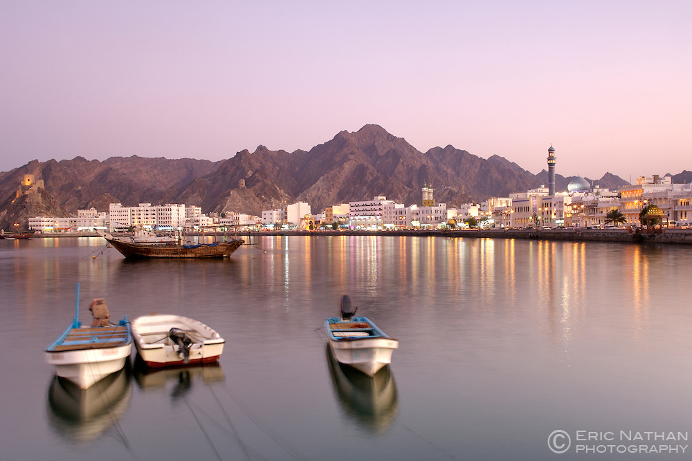 Dusk view of the Mutrah harbour and waterfront in Muscat, the capital of the sultanate of Oman.