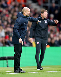 Manchester City manager Pep Guardiola (left) gestures on the touchline during the Premier League match at St Mary's Stadium, Southampton.