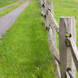 A split rail fence and farm road at the Essex County Greenbelt Association's Julia Bird Reservation in Ipswich, Massachusetts.
